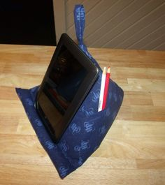 A triangular pyramid Pillow tablet stand with tutorial - Just what I've been looking for to hold the baby's tablet at a good angle for him.