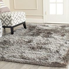 Rug from South Beach Shag collection. from Safavieh's South Beach Shag Collection, is a latte colored shag rug crafted w/ a texture blend of plush yarns for a luxurious shag pile. South Beach, High Pile Rug, Polyester Rugs, Shaggy Rug, Floor Decor, Online Home Decor Stores, Carpet Runner, Throw Rugs, Colorful Rugs