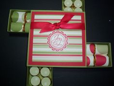 This cute box of candy would be a great gift for teachers, co-workers, your beauticians or manicurists.  It is made out of card stock and designer series papers.  Designer series papers serve as outer wrappers for the Rollo's and chocolate Nuggets.  It's actually a square box with 4 drawers containing the candy.