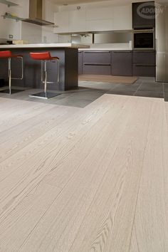 This textured bleached white oak flooring comes from Italian manufacturer Cadorin. Each plank has been brushed to remove the softer wood from the grain. Rustic Laminate Flooring, Vinyl Flooring, Hardwood Floors, Oak Flooring, Buy Reclaimed Wood, Bleached Wood, White Oak Floors, Oak Color, Wood Vinyl