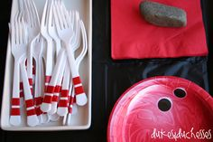 Add dots to plates to make them look like bowling balls, and add duct tape stripes to forks to make them look like pins! #bowling #party