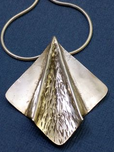 """Sterling Silver Fold Formed """"Paper Airplane"""" Pendant by sutrajewelry on Etsy"""