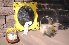 Seating sign on vintage mirror, programs in tin basket, and tissues for ceremony in vintage basket