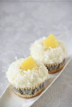 Coconut Cupcakes with Pineapple Curd by Xiaolu // 6 Bittersweets, via Flickr