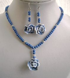 BLUE PEARL FLOWER NECKLACE AND EARRING SET £ 10.00 - Creative Connections