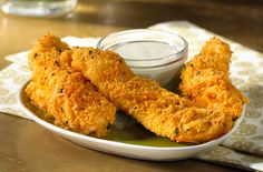 "Crunchy Cheese Chicken Tenders |  ""Sunshine® Cheez-It® Original crackers combine with Parmesan cheese in the crispy coating on these chicken fingers. They're great for lunch or as a snack during the big game...."""