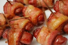 Little smoked sausages wrapped in bacon, glazed with brown sugar and dipped in your favorite Sweet Baby Ray's sauce.