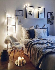 Check out the small clusters of frames on either side of the bed. If the bed is centered under a window like ours is, that's a great way to add some accent