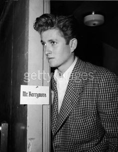 American actor John Drew Barrymore (1932 - 2004) looks through the doorway of his dressing room, early 1950s. Barrymore was the son of American actor John Barrymore and Dolores Costello, and the father of American actress Drew Barrymore.