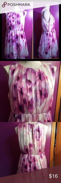 Jennifer lopez purple water color dress size 10 Size 10 watercolor dress by jennifer lopez. Variations of purple and cream. Has belt loops but does not come with a belt.  Approximately 18.5in armpit to armpit,15.5in waist, 35.5in length Jennifer Lopez Dresses