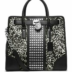 Michael Kors Calf Hair Studded Stipe Hamilton Michael Kors Hamilton with black and white calf hair and a center stripe with studs. Wonderful condition. No wear spots in the calf hair. This is the large size. Michael Kors Bags Totes