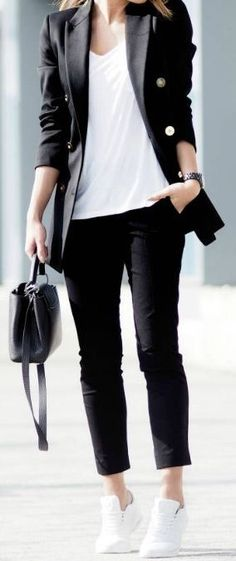 Dress down your suit pieces with a basic tee and fresh white sneakers. A great bag finishes the look.