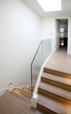 Parsons Green Terraced House: London Minimal modern stair in victorian house with frameless glass balustrade www.peekarchitecture.co.uk
