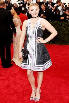 Chloe Grace Moretz in a custom bandanna-print Coach dress and choker necklace at the 2015 Met Gala