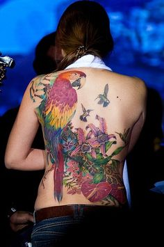 Great Parrot Tattoo! I want a blue and gold in a similar style, but on the opposite shoulder!! With Birds of Paradise flowers and bleeding hearts. This is my goal!