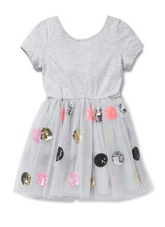 100% Cotton/100% Polyester Dress. Splice dress with cotton jersey top, with short sleeves and scooped neckline. Tulle skirts with multicoloured sequin spots on outer. Lined in 100% Cotton poplin. Regular fitting sihouette. Available in Cloud.