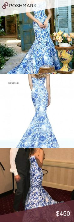 Sherri Hill Prom Dress. SZ 4. No Alterations Absolutely stunning Prom dress from  Sherri Hill. Excellent condition.  Strapless, mermaid prom dress with an all over beautiful floral print. Colors: Ivory/Blue Paid over $700.00  Wore one time for about 1 hour.   NO ALTERATIONS  **NO TRADES ** Sherri Hill Dresses Prom