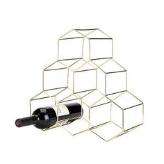 Belmont: Geo Wine Rack Brand: Viski Material: Gold plated stainless steel construction Holds six standard wine bottles Hexagon design Bottle Wall, Wine Bottle Holders, Wine Bottles, Beer Bottle, Tabletop, Wine Rack Cabinet, Wine Racks, Hanging Wine Glass Rack, Wine House