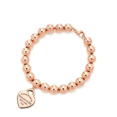 Return to Tiffany® small heart tag in 18k rose gold on a bead bracelet, medium.
