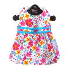 The Fiesta Turquoise and Hot Pink Floral Dog Dress will start a party. This lightweight whimsical design is perfect for Spring and Summer. Features floral swirl at waist under D-ring with a bright floral and butterfly print.