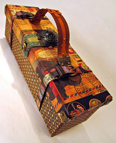 OK, a traveling wine box decoupaged with scrapbooking paper from Graphic 45 (we also carry this line of cool papers!)