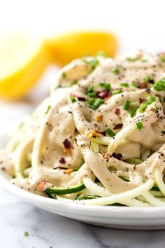 VEGAN LEMON CREAM SAUCE on top of spiralized zucchini noodles! A light and healthy dish that is burst with plant-based protein!