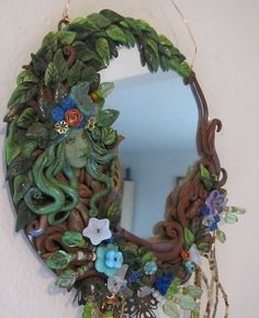 woodmirror - polymer clay idea have to bake pieces then glue onto mirror once cured.