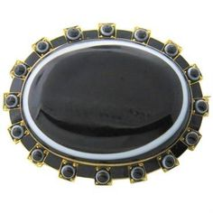 Circa 1870s Victorian brooch set in 15k gold,featuring agate gemstones and black enamel DESIGNER: Not Signed MATERIAL: 15k Gold GEMSTONE: Agate DIMENSIONS: Brooch is 43mm x 34mm WEIGHT: 26.4g CONDITION: Estate PRODUCT ID: 13032