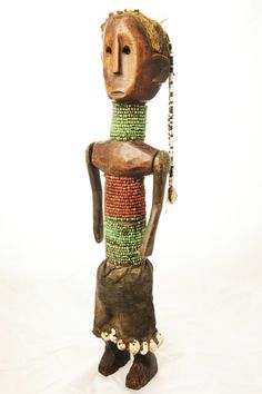 Africa | Articulated Doll from the Dinka people of southern Sudan | Wood, glass beads, hide and shells