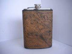 Steampunk Hand Tooled Leather Flask - Gears and Nuts and Bolts, oh my. $48.00, via Etsy.