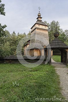 Old wooden Orthodox Church in open-air museum in Nowy Sącz and storm clouds…