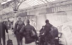 Passers by on a train home, January 16th 2017. Olympus OM10