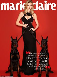 Fierce: Revenge star Emily VanCamp is flanked by two Doberman dogs as she poses in a low-cut sexy black gown for the April issue of Marie Claire Australia