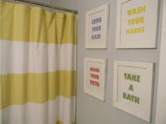 Simple wall art and curtain like this. Maybe paint the cabinets and mirror trim white. And a richer color for the walls.