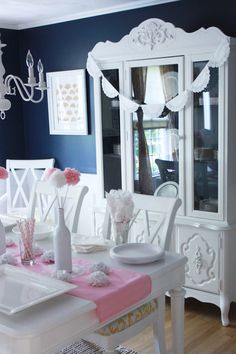 baptism party decor- the spray painted bottles with the white and pink flowers