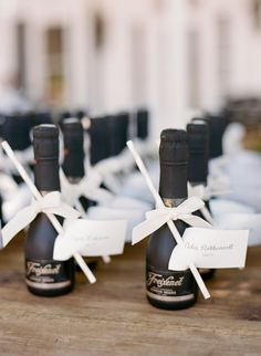 Personalized champagne favors: http://www.stylemepretty.com/little-black-book-blog/2015/11/23/sun-splashed-hammersky-vineyard-wedding/ | Photography: Josh Gruetzmacher - http://www.joshgruetzmacher.com/
