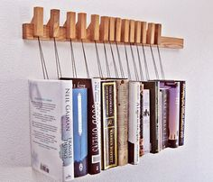Oak wood book rack (another one). Such a great idea! This site has all kinds of cool stuff like this.