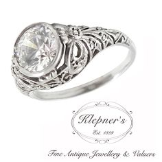 ART DECO INSPIRED FILIGREE ENGAGEMENT RING. This classic vintage inspired ring can be customized to include any combination of diamonds and/or gemstones such as sapphires, rubies, emeralds, birthstones, anniversary stones, etc & can be crafted in 9ct or 18ct white, rose or yellow gold, platinum or sterling silver. Prices vary depending on your unique specifications, please don't hesitate to contact us for a quote tailored for you. Visit us at www.klepners.com.au