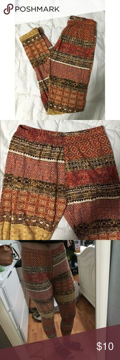 Boho Leggings Worn twice. Boho printed leggings. Size small. Suede like material. Elastic waistband. Golds, rust/orange and brownish colors. 🚫NO TRADES🚫 Pants Leggings