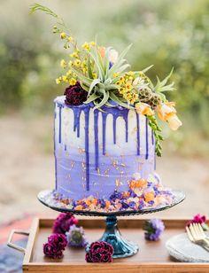 cosmic desert purple drip cake with gold flakes