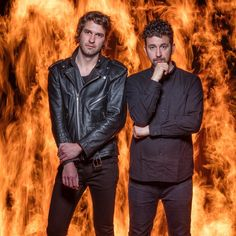 "Brian King, left, and David Prowse of Japan Droids, the deceptively noisy 2-piece punk band from Vancouver that just released a new album, ""Near to the Wild Heart of Life."" 🔥  You're probably wondering about this photo, though. Yes, the @japandroids are standing in front of a wall of fire. Well, sort of. When our staff photographer @cenicola0 was assigned to photograph Japan Droids, he thought fire would make an appropriate backdrop for the rock 'n' roll band. And so he used a time…"