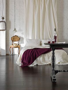 Simple: love the drape/curtain behind the bed