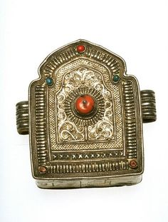 Tibet | Shrine shaped amulet box; silver and copper with semi precious stone inlays | 19th century
