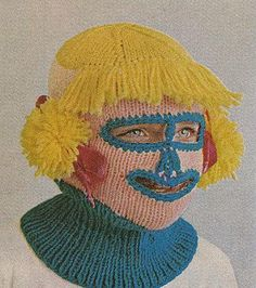 another creepy knitted mask that i simply had to add to my bizarro collection here. this one ups the ante with the clownish freak factor.