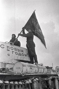 Soviet tank crew raising a flag on a KV-1 heavy tank, Moscow, Russia, 31 Dec 1941