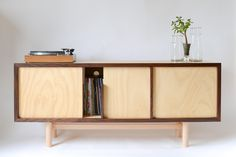 Hoop pine ply and solid walnut. Designed by Phill Badger for Sefton Powrie Furniture Ltd.