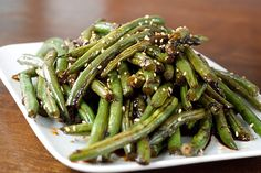 One of my Fav's! Cactus Club Szechuan Green Beans Recipe Ingredients 2 cups canola oil, plus 1 tablespoon 1 tablespoon minced fresh ginger 1 tablespoon minced garlic 1/4 cup soy sauce 1 ounce hot chili sauce 1/4 cup rice wine vinegar 2 tablespoons hoisin sauce 1 tablespoon mirin or white wine 1/2 teaspoon sesame oil 1 teaspoon chopped fresh ci