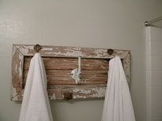 cute idea to hang towels...currently searching antique shops for an old frame or piece of wood to do this with