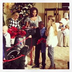 """Today First Lady Michelle Obama invited military families to the White House to introduce the holiday theme, """"Gather Around: Stories of the Season.""""  Of course, she and Bo took the families on a tour!"""