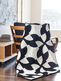 Tres Chic! Give a classic Drunkard's Path pattern a totally fresh look by creating the blocks in black and solid white. Find this pattern and 11 more in Dear Quilty: 12 Easy Patchwork Quilts & Great Quilting Advice by Mary Fons and Team Quilty.